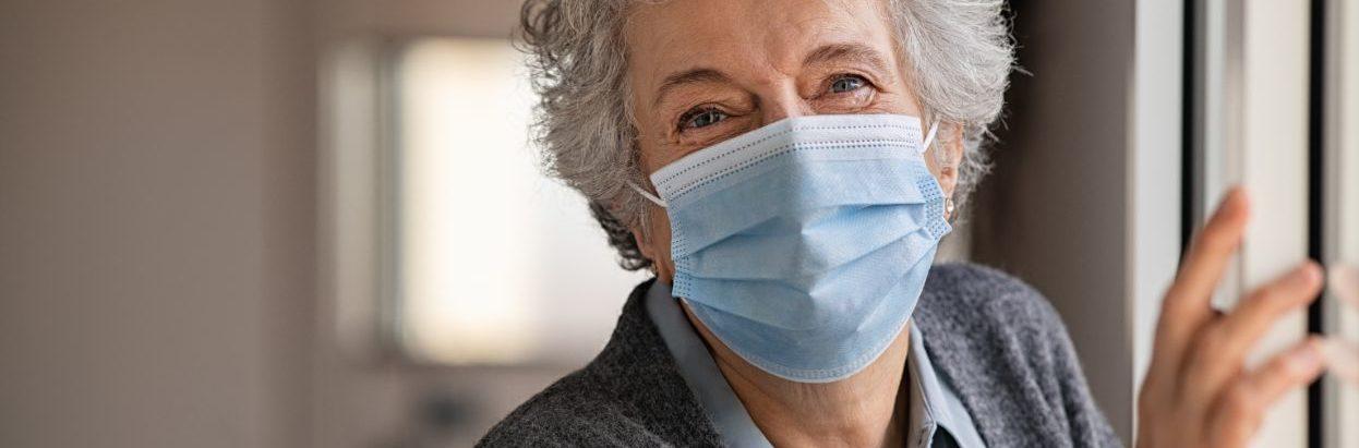 elderly senior woman wearing a mask for coronavirus